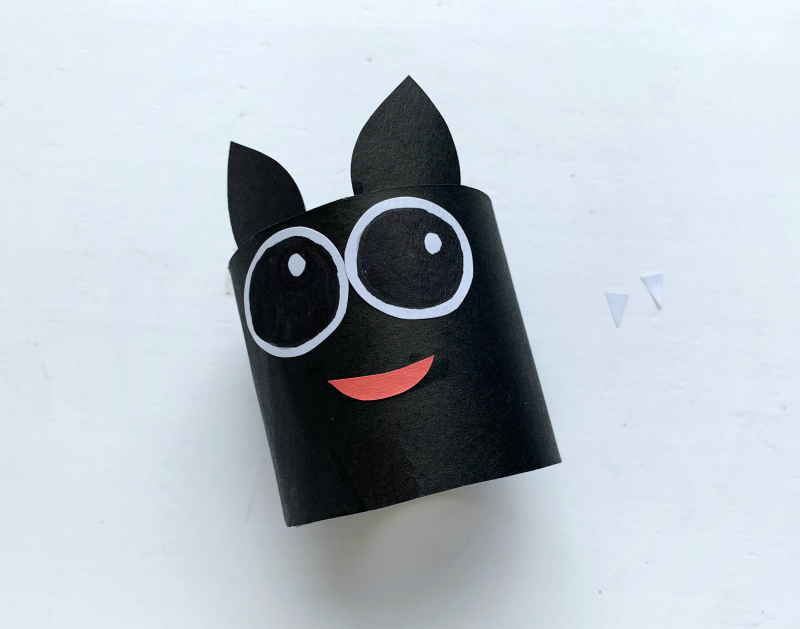 Cute toilet paper bat craft tutorial - step 6. attach the bat's ears and mouth.